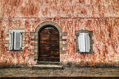Wooden door in a rustic wall Stock Photography