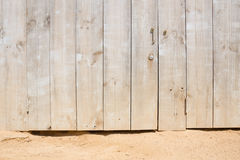 Wooden door on a sandy beach Stock Photography