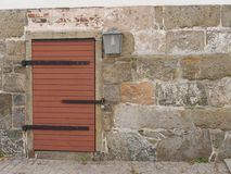 A door in a stonewall royalty free stock photos