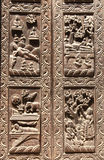 Wooden door with scenes from life of Buddha, Kathmandu, Nepal Stock Images