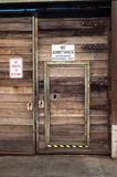 Wooden door in gate. A wooden door set in a gate, with signs describing no entry Stock Photos