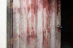 Wooden door with silver door knob. Vintage wooden door with silver door knob Royalty Free Stock Image