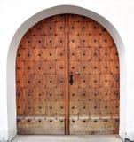 Wooden door with smith work Stock Photos