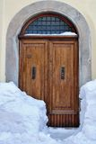 Wooden door with snow Royalty Free Stock Photos