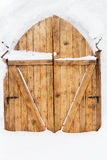 Wooden door in a snow palace Stock Photography