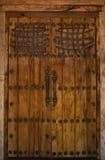 Wooden Door in Southwest. Old wooden door with black iron accents Stock Images