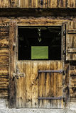 Wooden door of stable Stock Images