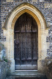 Wooden door and steps detail on 14th Century church Stock Photo