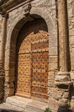 Wooden door and stone arch in ancient Châteaudouble church. Wooden door and stone arch in ancient Châteaudouble church, a quiet and tourist village with Royalty Free Stock Image