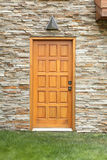 Wooden door on a stone wall Stock Images