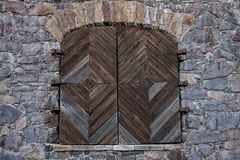 Wooden door in a stone wall Royalty Free Stock Image
