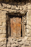 Wooden door in a stone wall stock photography