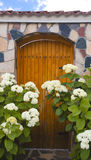 Wooden door on stone wall Royalty Free Stock Image