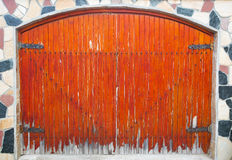 Wooden door on stone wall Royalty Free Stock Photo