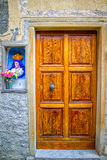 Wooden Door with Stucco and Religious Icon in Cannes, France Stock Images