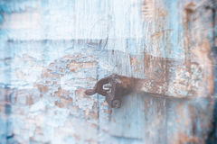 Wooden door surface with padlock, abstract background with two layers Stock Photography