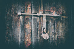 Wooden door surface with padlock, abstract background with two layers Royalty Free Stock Photography