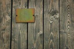 Wooden door &  tablet. Old wooden door with the tablet Stock Photo