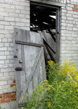 A wooden door, taken from its hinges. In a destroyed farmhouse Stock Images