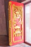 The wooden door of Thai pagoda. The wooden door of Northeast Thai pagoda, Thailand Stock Photography