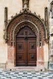 Wooden door to city hall. In prague Stock Photography