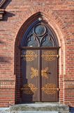 The wooden door to the Gothic church Stock Photo