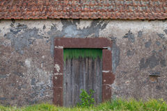 Wooden door to an old cottage Royalty Free Stock Photo