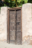Wooden door with traditional carving Royalty Free Stock Images