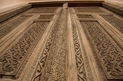 Wooden door with traditional carvings. Brown wooden door with traditional carvings in the city of Khiva, Uzbekistan Stock Photos