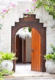 Wooden door of the tropical garden villa. In beach resort royalty free stock image