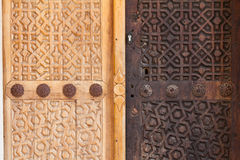 Wooden door with two crosses Royalty Free Stock Image