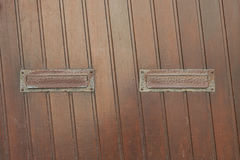 Wooden door with two mail slots.  Royalty Free Stock Photography