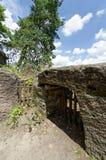 Wooden door under the rock Royalty Free Stock Images