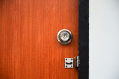 Wooden door unlocked with padlock, High dynamic range and contrast. royalty free stock photo