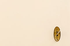 Wooden door with vintage keyhole and key. A vintage brass keyhole with the key inserted Stock Image
