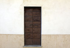 Wooden door in a wall Royalty Free Stock Photography