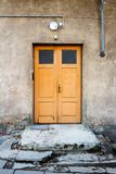 Wooden door on a wall Royalty Free Stock Photo