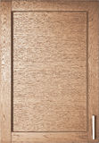 Wooden door of wardrobe in kitchen Stock Image