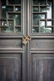 Wooden door was locked by rusty old lock Stock Photo