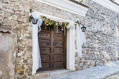 Wooden door with wedding decoration Royalty Free Stock Photo