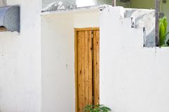 Wooden door of a white maldivian house stock photography