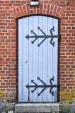 Wooden door wih ornamental metal hinge Stock Photography
