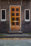 Wooden door and windows in European town Stock Images