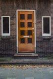 Wooden door and windows in European town Stock Images
