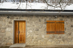 Wooden door and window. Facade of small hous at winter Royalty Free Stock Images