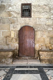 Wooden door and window covered with interleaved wooden grid Royalty Free Stock Image