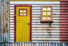 Detail of a wooden hut. Wooden door and window - detail of a wooden hut Royalty Free Stock Photos
