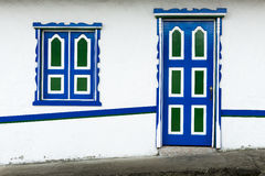 Wooden door and window painted in bright colors in a traditional colonial house in the town of Salento, in Colombia Royalty Free Stock Image