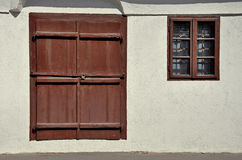 Wooden door and window in white wall Royalty Free Stock Photo