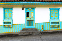 Wooden door and windows painted in bright colors in a traditional colonial house in the town of Salento, in Colombia Stock Photo
